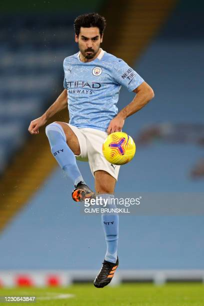 Manchester City's German midfielder Ilkay Gundogan controls the ball during the English Premier League football match between Manchester City and...