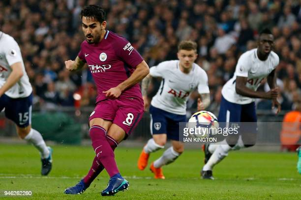 Manchester City's German midfielder Ilkay Gundogan scores their second goal from the penalty spot during the English Premier League football match...