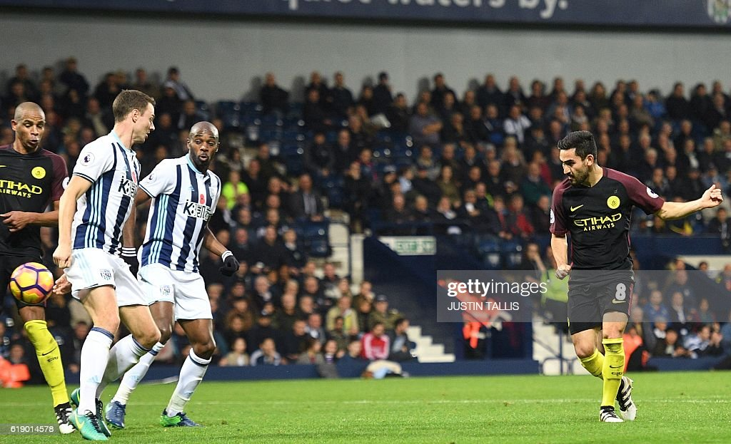 Manchester City's German midfielder Ilkay Gundogan (R) shoots to score their fourth goal during the English Premier League football match between West Bromwich Albion and Manchester City at The Hawthorns stadium in West Bromwich, central England, on October 29, 2016. Manchester City won the game 4-0. / AFP / Justin TALLIS / RESTRICTED TO EDITORIAL USE. No use with unauthorized audio, video, data, fixture lists, club/league logos or 'live' services. Online in-match use limited to 75 images, no video emulation. No use in betting, games or single club/league/player publications. /