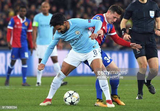 Manchester City's German midfielder Ilkay Gundogan vies for the ball with Basel's Albanian midfielder Taulant Xhaka during the UEFA Champions League...