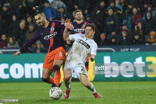 Manchester City's German midfielder Ilkay Gundogan vies with Swansea City's Welsh midfielder Daniel James during the FA Cup quarterfinal football...