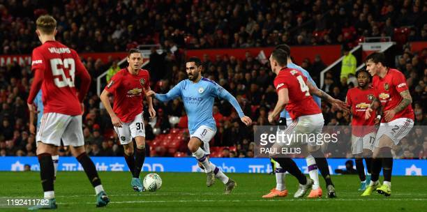 TOPSHOT Manchester City's German midfielder Ilkay Gundogan vies with Manchester United's Serbian midfielder Nemanja Matic during the English League...