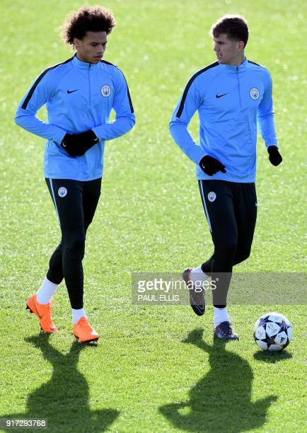 Manchester City's German midfielder Leroy Sane and English defender John Stones takes part in a training session in Manchester north west England on...