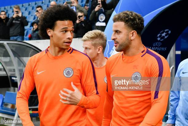 Manchester City's German midfielder Leroy Sane and Manchester City's English defender Kyle Walker come on to the pitch for the watm up prior to the...