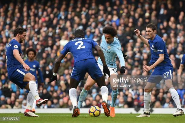 Manchester City's German midfielder Leroy Sane breaks past Chelsea's Chelsea's German defender Antonio Rudiger during the English Premier League...