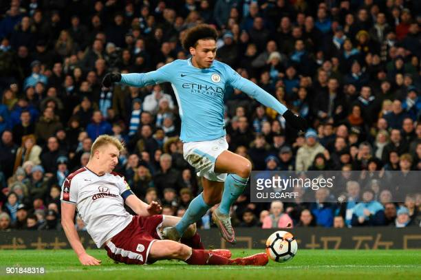 Manchester City's German midfielder Leroy Sane breaks through to scores their third goal during the English FA Cup third round football match between...
