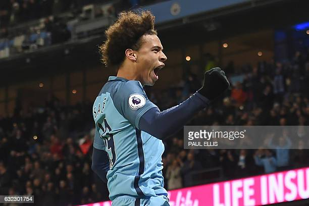 Manchester City's German midfielder Leroy Sane celebrates after scoring the opening goal of the English Premier League football match between...