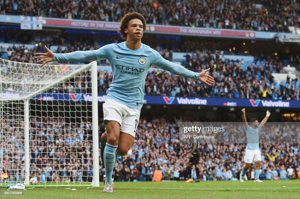 Manchester City's German midfielder Leroy Sane celebrates after scoring during the English Premier League football match between Manchester City and Crystal Palace at the Etihad Stadium in Manchester, north west England, on September 23, 2017. / AFP PHOTO / PAUL ELLIS / RESTRICTED TO EDITORIAL USE. No use with unauthorized audio, video, data, fixture lists, club/league logos or 'live' services. Online in-match use limited to 75 images, no video emulation. No use in betting, games or single club/league/player publications. /