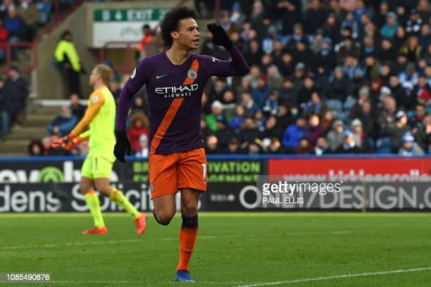 Manchester City's German midfielder Leroy Sane celebrates after scoring their third goal during the English Premier League football match between...