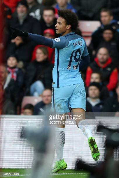 Manchester City's German midfielder Leroy Sane celebrates after scoring their second goal during the English Premier League football match between...
