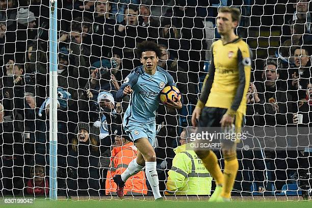 Manchester City's German midfielder Leroy Sane celebrates scoring his team's first goal during the English Premier League football match between...