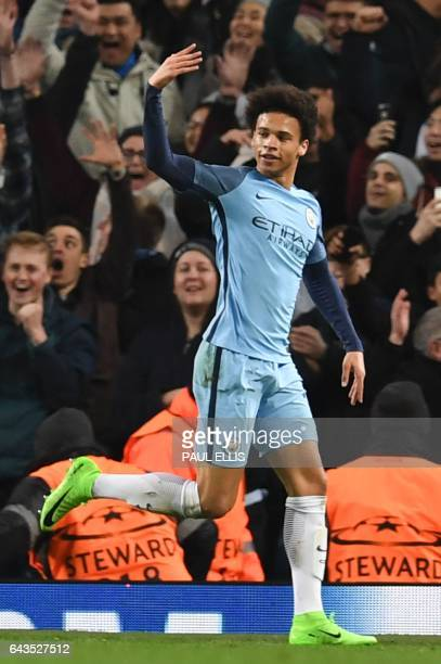Manchester City's German midfielder Leroy Sane celebrates scoring their fifth goal during the UEFA Champions League Round of 16 firstleg football...