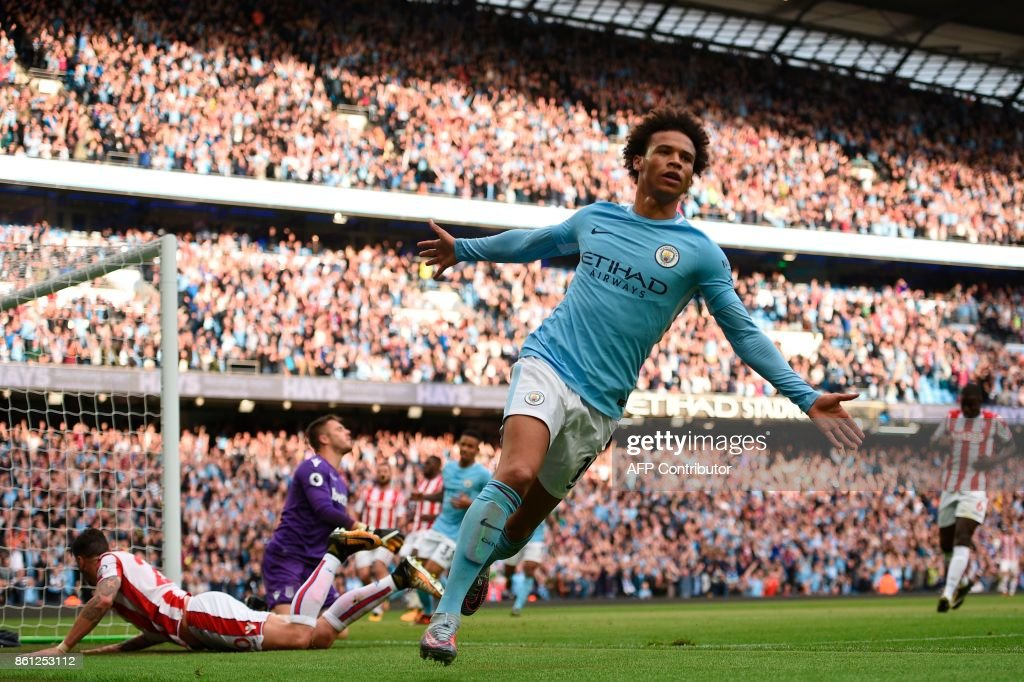 Manchester City's German midfielder Leroy Sane celebrates scoring their sixth goal during the English Premier League football match between Manchester City and Stoke City at the Etihad Stadium in Manchester, north west England, on October 14, 2017. / AFP PHOTO / Oli SCARFF / RESTRICTED TO EDITORIAL USE. No use with unauthorized audio, video, data, fixture lists, club/league logos or 'live' services. Online in-match use limited to 75 images, no video emulation. No use in betting, games or single club/league/player publications. /