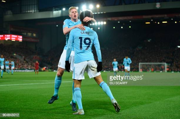 Manchester City's German midfielder Leroy Sane celebrates scoring their first goal to equalise 11 with Manchester City's Belgian midfielder Kevin De...