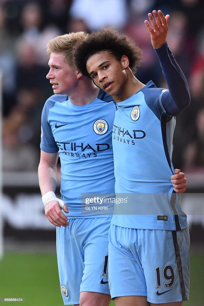 Manchester City's German midfielder Leroy Sane (R) celebrates with Manchester City's Belgian midfielder Kevin De Bruyne after scoring their second goal during the English Premier League football match between Southampton and Manchester City at St Mary's Stadium in Southampton, southern England on April 15, 2017. / AFP PHOTO / Glyn KIRK / RESTRICTED TO EDITORIAL USE. No use with unauthorized audio, video, data, fixture lists, club/league logos or 'live' services. Online in-match use limited to 75 images, no video emulation. No use in betting, games or single club/league/player publications. /