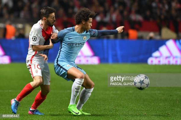 Manchester City's German midfielder Leroy Sane challenges Monaco's Portuguese midfielder Bernardo Silva during the UEFA Champions League round of 16...