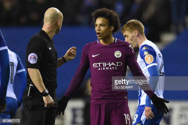 Manchester City's German midfielder Leroy Sane interacts with referee Anthony Taylor during the English FA Cup fifth round football match between...