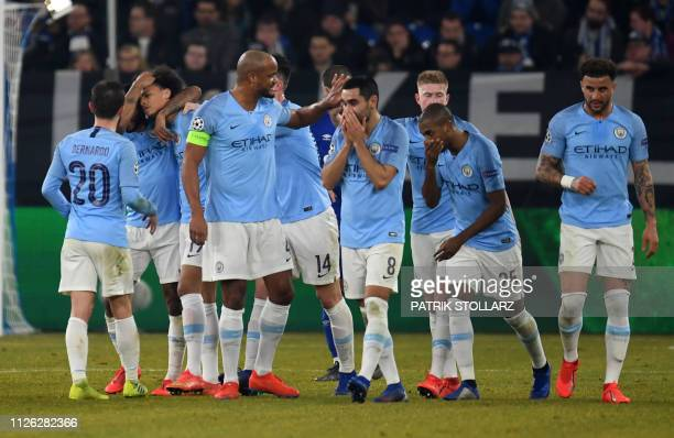 Manchester City's German midfielder Leroy Sane is congratulated by teammates after scoring a goal during the UEFA Champions League round of 16 first...