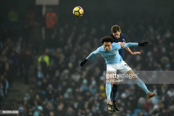 Manchester City's German midfielder Leroy Sane jumps for the ball with Tottenham Hotspur's Belgian defender Jan Vertonghen during the English Premier...