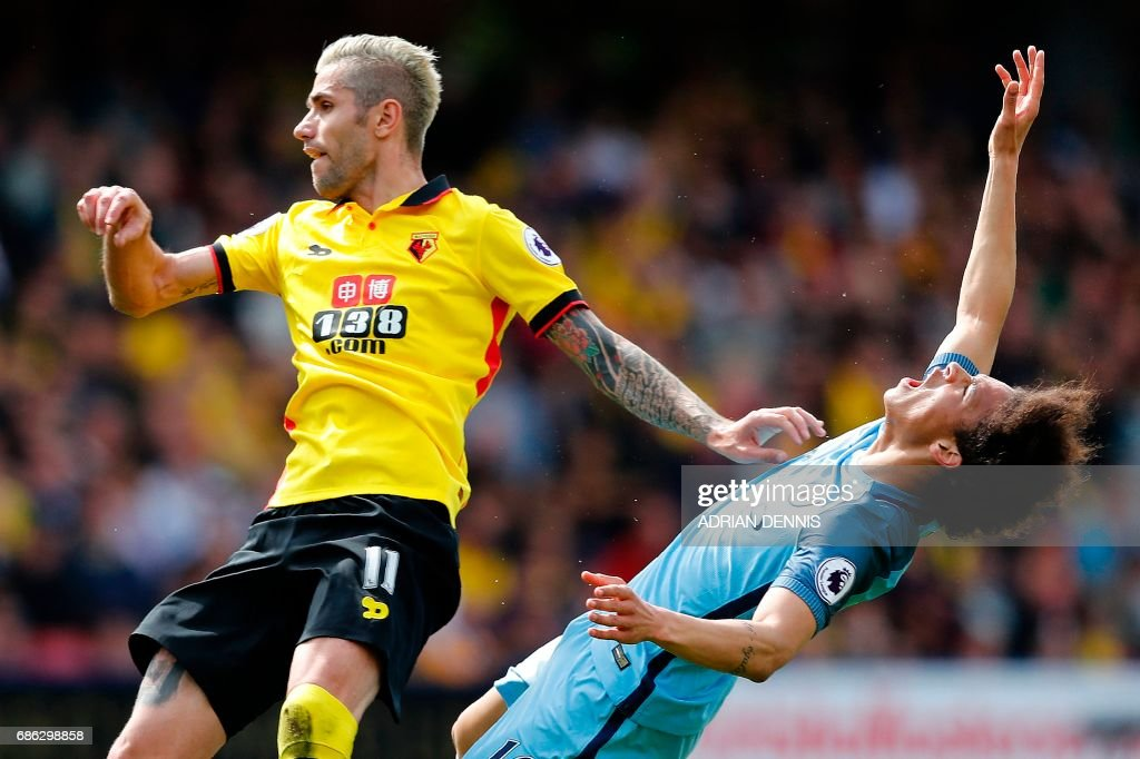 Manchester City's German midfielder Leroy Sane (R) reacts after colliding with Watford's Yugoslavian-born Swiss midfielder Valon Behrami during the English Premier League football match between Watford and Manchester City at Vicarage Road Stadium in Watford, north of London on May 21, 2017. / AFP PHOTO / Adrian DENNIS / RESTRICTED TO EDITORIAL USE. No use with unauthorized audio, video, data, fixture lists, club/league logos or 'live' services. Online in-match use limited to 75 images, no video emulation. No use in betting, games or single club/league/player publications. /