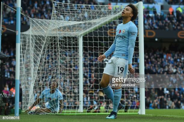 Manchester City's German midfielder Leroy Sane reacts after failing to score during the English Premier League football match between Manchester City...