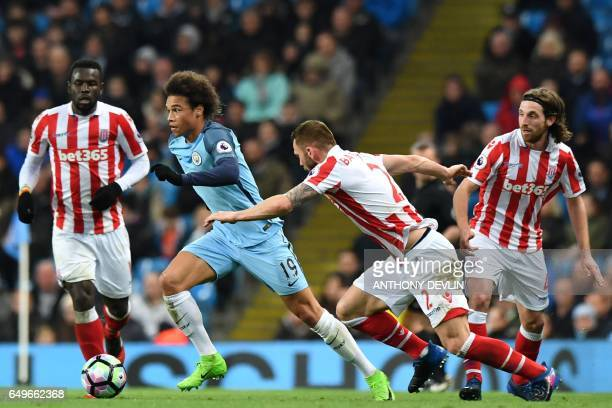 Manchester City's German midfielder Leroy Sane runs away from Stoke City's Englishborn Scottish defender Phil Bardsley during the English Premier...