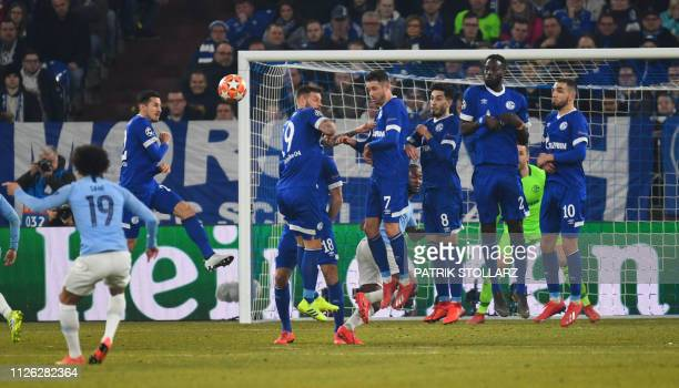 Manchester City's German midfielder Leroy Sane scores a goal during the UEFA Champions League round of 16 first leg football match between Schalke 04...