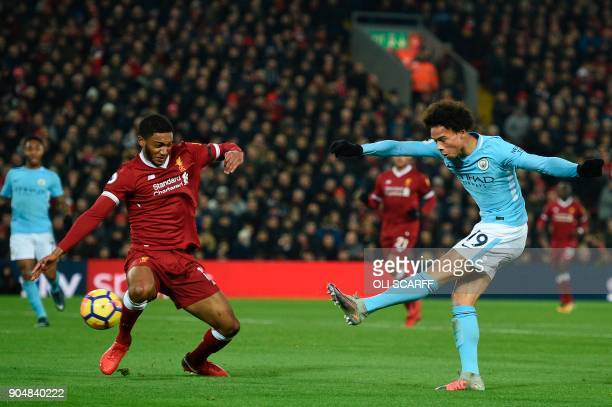Manchester City's German midfielder Leroy Sane scores their first goal to equalise 11 during the English Premier League football match between...