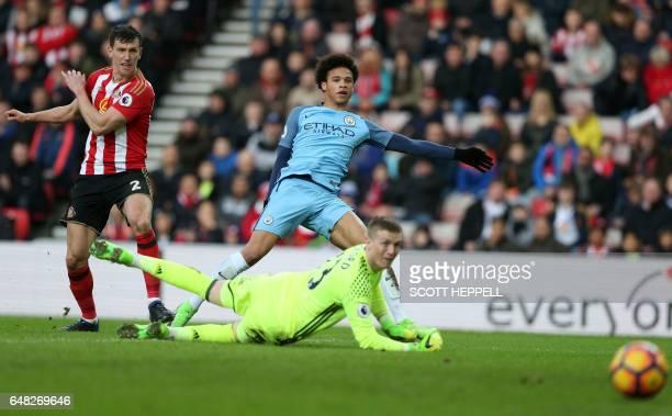 Manchester City's German midfielder Leroy Sane scores their second goal past Sunderland's English goalkeeper Jordan Pickford during the English...