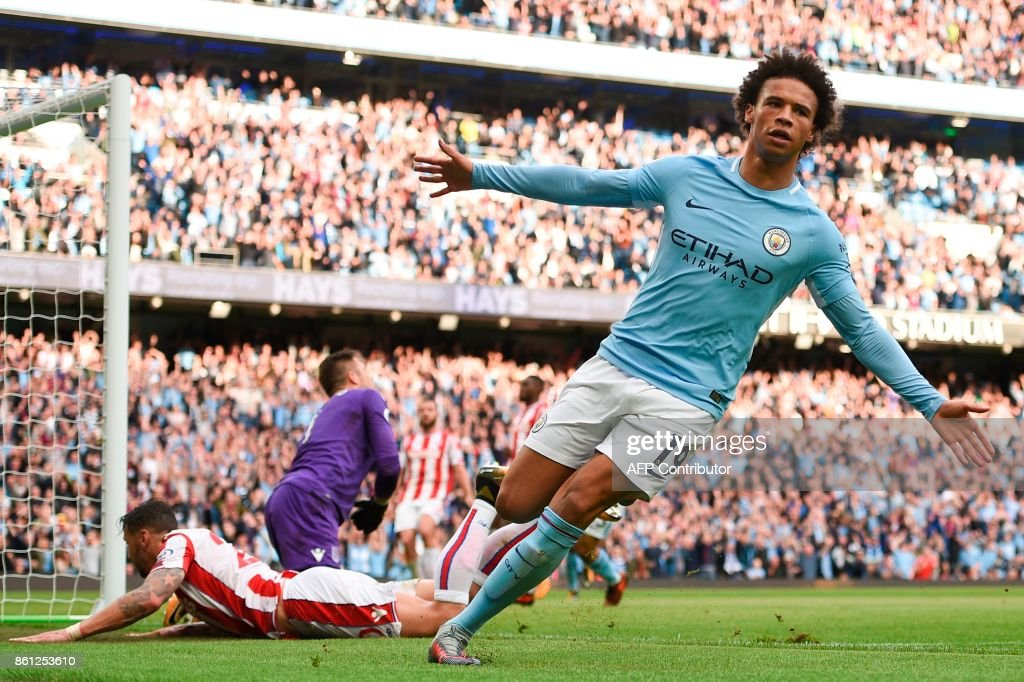 Manchester City's German midfielder Leroy Sane scores their sixth goal during the English Premier League football match between Manchester City and Stoke City at the Etihad Stadium in Manchester, north west England, on October 14, 2017. / AFP PHOTO / Oli SCARFF / RESTRICTED TO EDITORIAL USE. No use with unauthorized audio, video, data, fixture lists, club/league logos or 'live' services. Online in-match use limited to 75 images, no video emulation. No use in betting, games or single club/league/player publications. /