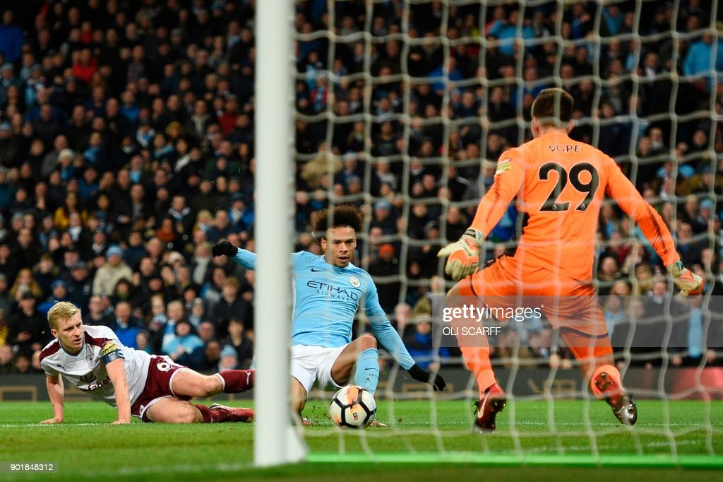 Manchester City's German midfielder Leroy Sane (C) scores their third goal during the English FA Cup third round football match between Manchester City and Burnley at Etihad Stadium in Manchester, north west England on January 6, 2018. / AFP PHOTO / Oli SCARFF / RESTRICTED TO EDITORIAL USE. No use with unauthorized audio, video, data, fixture lists, club/league logos or 'live' services. Online in-match use limited to 75 images, no video emulation. No use in betting, games or single club/league/player publications. /