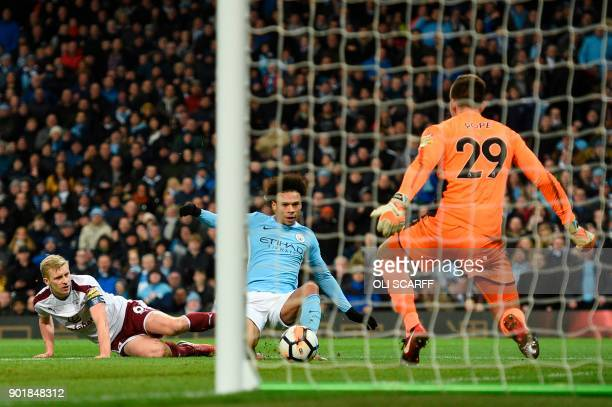 Manchester City's German midfielder Leroy Sane scores their third goal during the English FA Cup third round football match between Manchester City...
