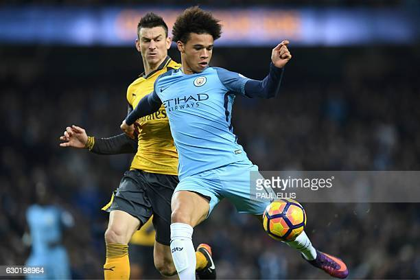 Manchester City's German midfielder Leroy Sane shoots the score their first goal during the English Premier League football match between Manchester...