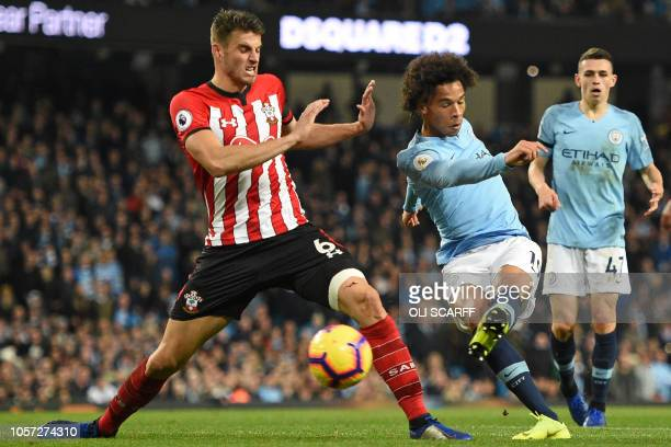 TOPSHOT Manchester City's German midfielder Leroy Sane shoots to score their sixth goal during the English Premier League football match between...