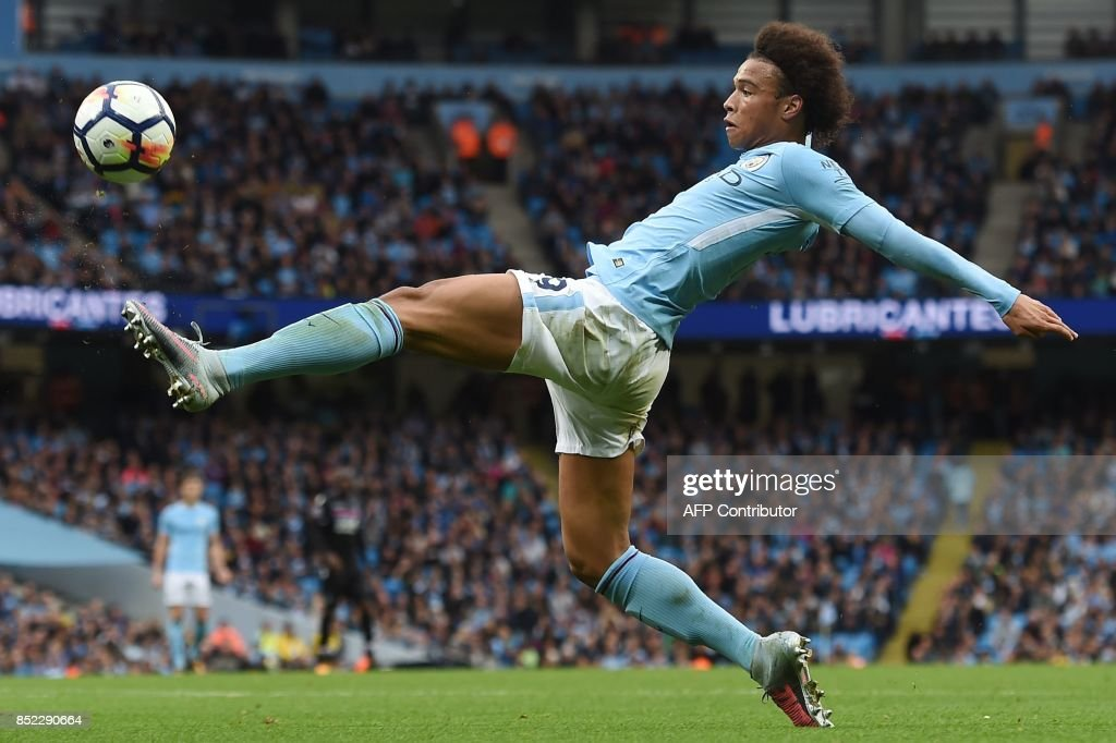 TOPSHOT - Manchester City's German midfielder Leroy Sane stretches for the ball during the English Premier League football match between Manchester City and Crystal Palace at the Etihad Stadium in Manchester, north west England, on September 23, 2017. / AFP PHOTO / PAUL ELLIS / RESTRICTED TO EDITORIAL USE. No use with unauthorized audio, video, data, fixture lists, club/league logos or 'live' services. Online in-match use limited to 75 images, no video emulation. No use in betting, games or single club/league/player publications. /
