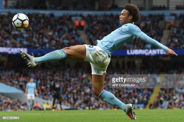 TOPSHOT Manchester City's German midfielder Leroy Sane stretches for the ball during the English Premier League football match between Manchester...
