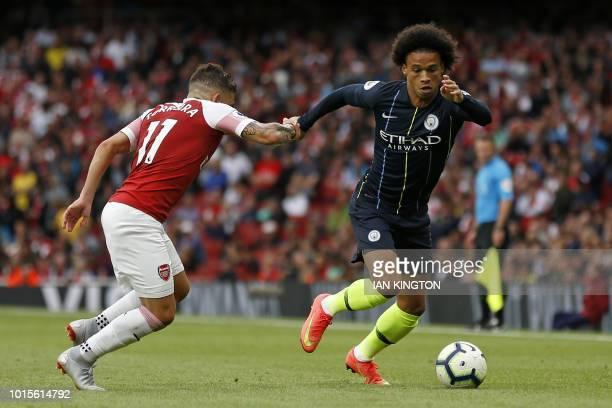 Manchester City's German midfielder Leroy Sane vies with Arsenal's Uruguayan midfielder Lucas Torreira during the English Premier League football...