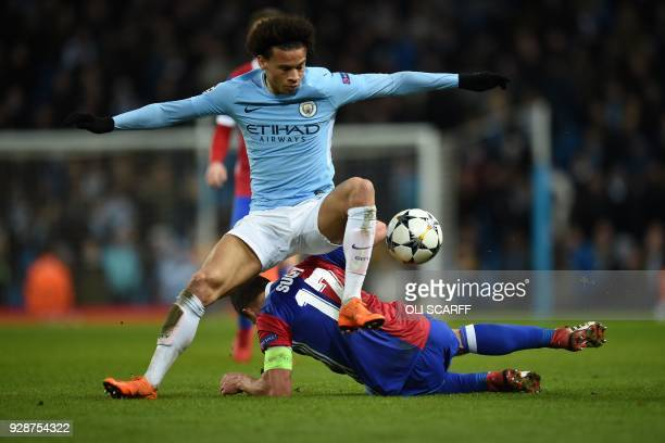 Manchester City's German midfielder Leroy Sane vies with Basel's Czech defender Marek Suchy during the UEFA Champions League round of sixteen second...