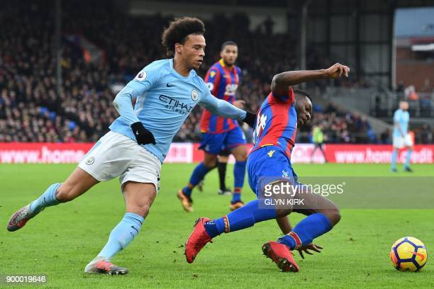 Manchester City's German midfielder Leroy Sane vies with Crystal Palace's Dutch defender Timothy FosuMensah during the English Premier League...