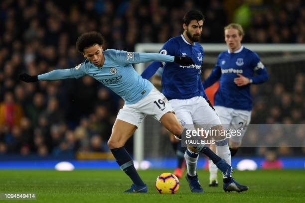 Manchester City's German midfielder Leroy Sane vies with Everton's Portuguese midfielder André Gomes during the English Premier League football match...