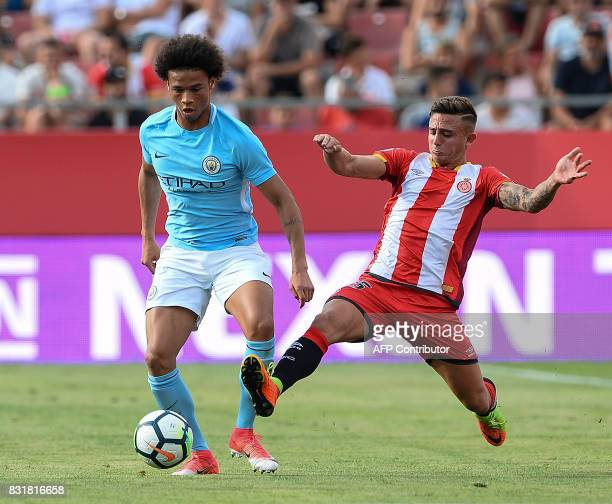 Manchester City's German midfielder Leroy Sane vies with Girona's defender Pablo Maffeo during the annual 41st Costa Brava Trophy friendly football...