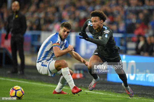 Manchester City's German midfielder Leroy Sane vies with Huddersfield Town's English defender Tommy Smith during the English Premier League football...