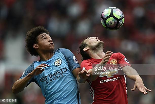 Manchester City's German midfielder Leroy Sane vies with Manchester United's Dutch midfielder Daley Blind during the English Premier League football...