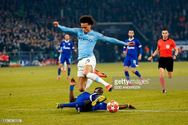Manchester City's German midfielder Leroy Sane vies with Schalke's Senegalese defender Salif Sane during the UEFA Champions League round of 16 first...