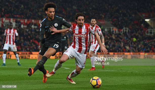 Manchester City's German midfielder Leroy Sane vies with Stoke City's Welsh midfielder Joe Allen during the English Premier League football match...