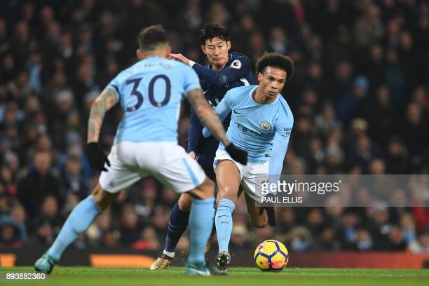 Manchester City's German midfielder Leroy Sane vies with Tottenham Hotspur's South Korean striker Son HeungMin during the English Premier League...