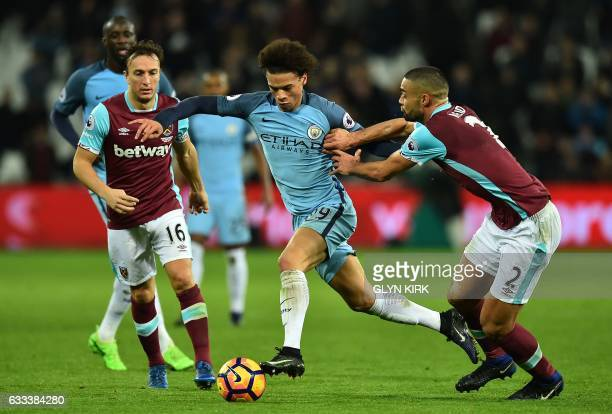 Manchester City's German midfielder Leroy Sane vies with West Ham United's English midfielder Mark Noble and West Ham United's New Zealand defender...