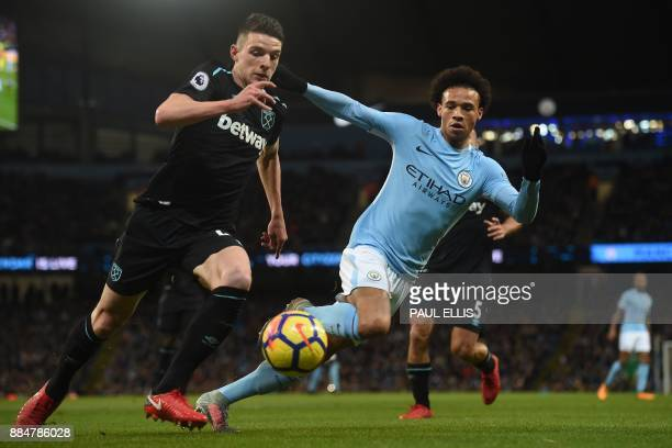 Manchester City's German midfielder Leroy Sane vies with West Ham United's Irish defender Declan Rice during the English Premier League football...