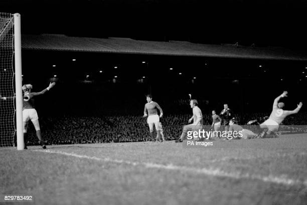 Manchester City's Ian Bowyer scores his team's first goal as teammate Francis Lee tries to win a penalty watched by Manchester United's Ian Ure Tony...