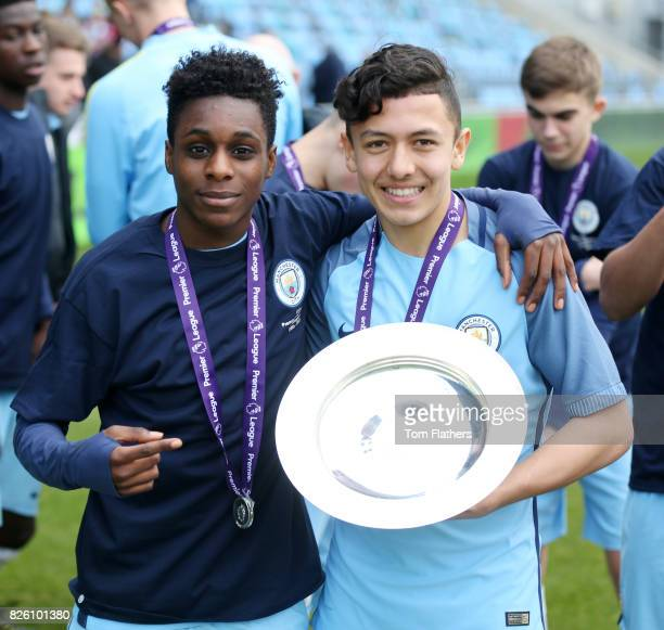 Manchester City's Iancarlo Poveda and Jeremie Frimpong celebrate winning the U18 Northern Premier League trophy